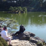 At a Japanese Garden rest Sumo wrestlers after the morning training