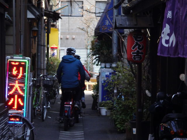 Riding through the back alley of Tsukishima